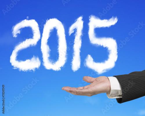 Leinwandbild Motiv Hand holding 2015 shape cloud with blue sky