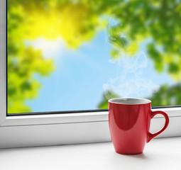 cup of tea on the windowsill