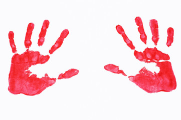 Multi colored painted hand prints arranged in a circle on a whit