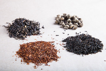 Four kinds of tea on a paper background