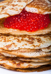 Russian pancakes - blini with red caviar