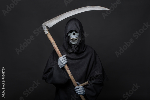 Poster Death with scythe standing in the dark. Halloween