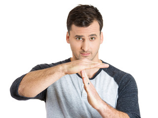 Handsome man showing time out hand gesture