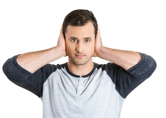 Portrait young man covering his ears with hands