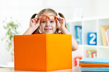 happy smiling kid girl with books, education concept