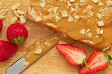 Peanut butter sandwich on a wood background
