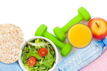 Dumbells, healthy food and towels. Fitness and health. Isolated
