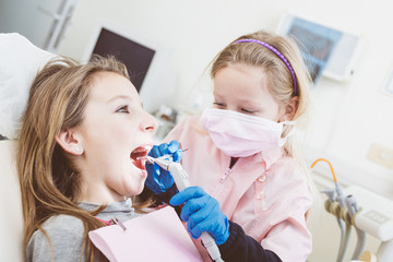 Little Girls Dentist and Patient During Dental Examination.