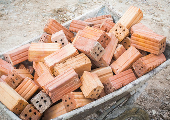 red brick on the wheelbarrow for construction