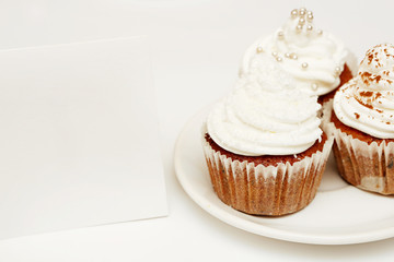 Cupcakes with whip cream and blank card - add own text