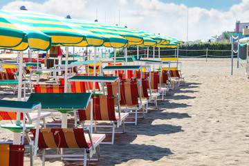 Sunbeds and umbrellas on the beach in the resort town Bellaria I