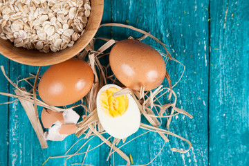 Organic eggs on blue wood background