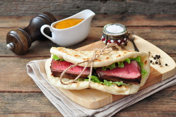 Pita with Juicy steak slices