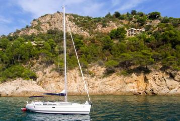 A sailing boat near the coastline of Costa Brava