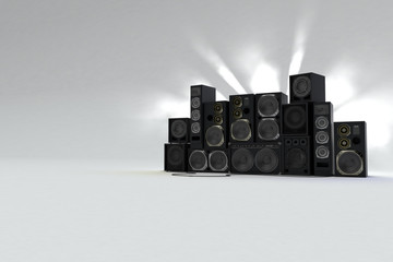 sound speakers on white background with light behind. Right view