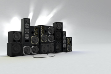 Sound speakers on white background with light behind. Left view