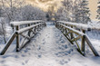Wooden bridge, covered with snow. Stare Juchy, Poland. - 78269705
