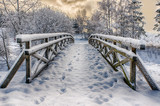 Fototapety Wooden bridge, covered with snow. Stare Juchy, Poland.