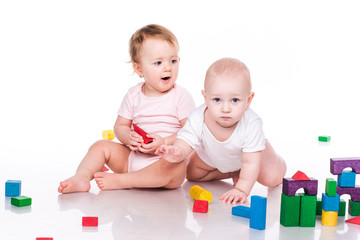 Beautiful babies building with cubes