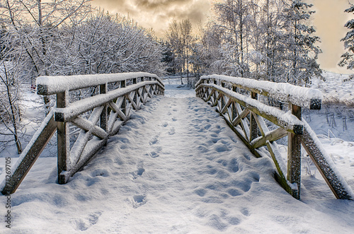Wooden bridge, covered with snow. Stare Juchy, Poland.