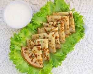 thin pancakes with fresh herbs