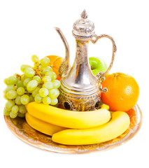 Fruits and  jar on a plate