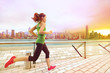 canvas print picture - Urban runner woman jogging in Hong Kong at sunset