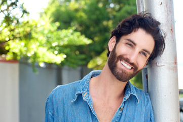 Close up happy man with beard smiling outdoors