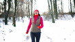 Breathless woman running in snowy forest, steady, slow motion