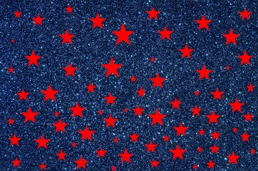Red stars on blue glitter background