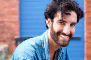 Trendy modern man with beard smiling