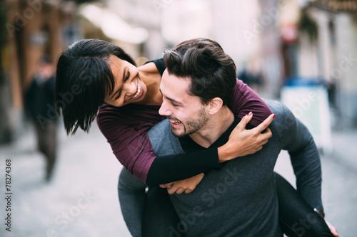 Interracial couple in love having fun in the city - 78274368