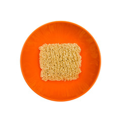 Dry instant Noodle in orange bowl on the white background