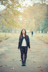young beautiful brunette straight hair woman in the park