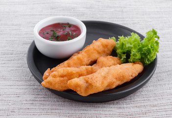 Fried fish fingers with sauce