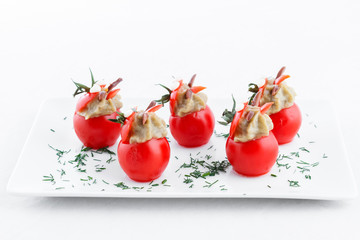 Many small tomatoes stuffed with  eggplant baba ganoush