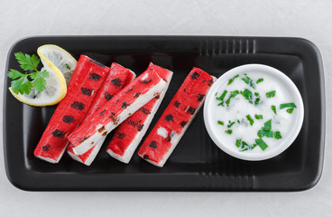 Grilled surimi sticks, kamaboko, seafood, white fish, garlic dip