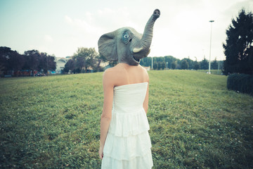 elephant mask beautiful young woman with white dress