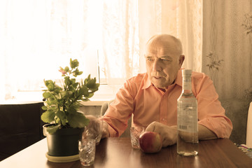 Old Drinking Man Looking at Plant on the Table