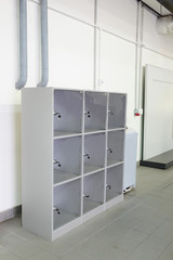 grey luggage storage with cells in the service station