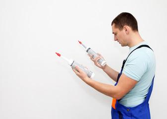 Man choosing silicone sealant