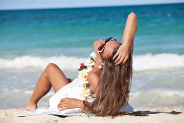 Free happy woman on beach enjoying nature.