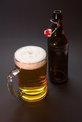 Half liter glass and bottle with traditional cap of czech beer