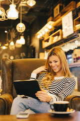 Modern woman sitting in coffee shop