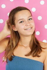 teen girl portrait on pink