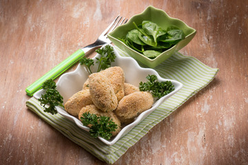 rice croquette with fresh spinach salad