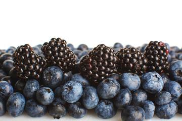Freshly picked blueberries and blackberries close-up