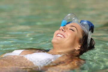Tourist woman bathing on a tropical beach on holidays
