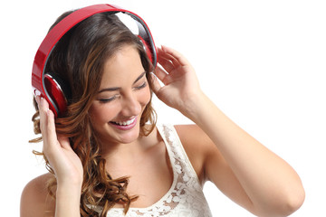 Happy woman enjoying listening to the music from headphones