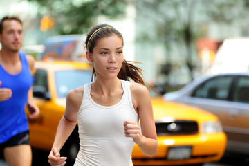 Active people jogging on New York city street, NYC